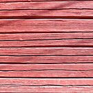 Old red plank wall by Kristian Tuhkanen