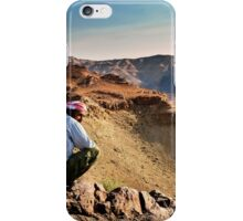 A local beduin looks out over the desert mountains iPhone Case/Skin