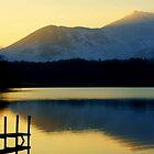 Winter Sunset On Derwent Water by Lou Wilson