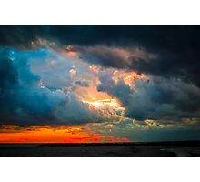 sunset through grey storm clouds  Photographic Print