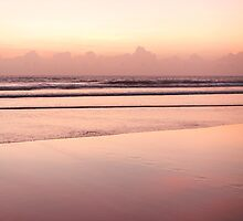 sandy beach in red dawn sky by Hakai Matsu