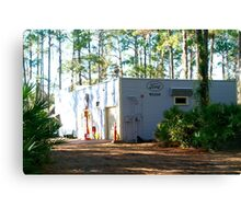 Old-timey service station under the pines Canvas Print