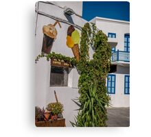 Typical Greek coffee shop  Mandraki town Nisyros Island  Aegean Sea Canvas Print