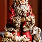 Santa Adoring the Christ Child by Bonnie T.  Barry