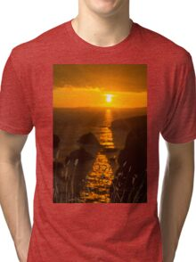 beautiful sunset over the coastal rocks with wild highl grass Tri-blend T-Shirt