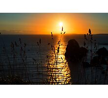 beautiful sunset over the virgin rock grass Photographic Print