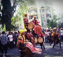 Folk Dancers at an Art Mela by Vandana Indramohan