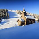 Winter chapel on the hill in the Alps by Zoltán Duray