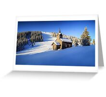 Winter chapel on the hill in the Alps Greeting Card