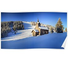 Winter chapel on the hill in the Alps Poster