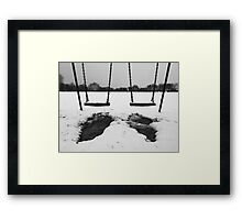 Swings in thawing snow Framed Print