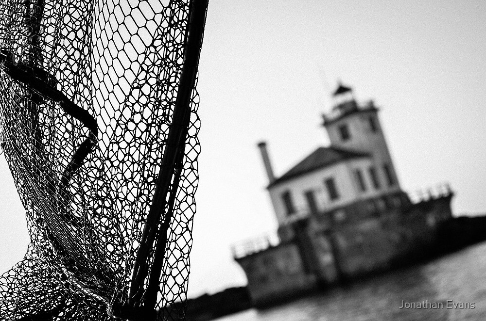 A Black and White Lighthouse by Jonathan Evans