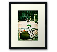 An empty chair in a big plaza Framed Print