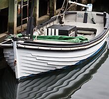 Dinghy reflection by Roger Neal