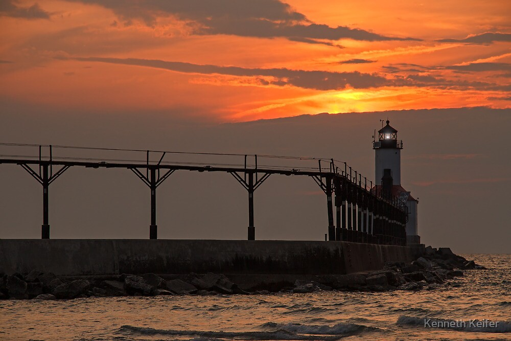 Sunset over the Michigan City Light, Indiana (on Lake Michigan) by Kenneth Keifer