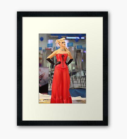 girl in a red dress Framed Print