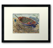 Old shabby boat on sand Framed Print