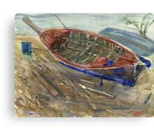 Old shabby boat on sand Canvas Print