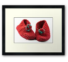 Red knitted slippers Framed Print
