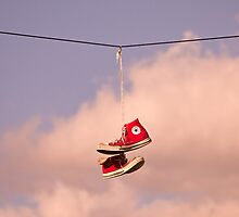 Red Trainers on a wire by aSandor