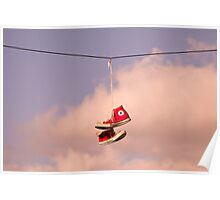 Red Trainers on a wire Poster