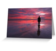 Sunset on one of Gormley's statues on Crosby Beach Greeting Card