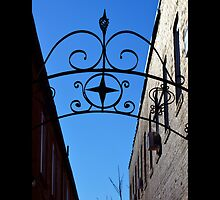 Alley With Wrought Iron Gate On East Main Street - Riverhead, New York by © Sophie W. Smith