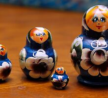 Four blue nesting dolls by Jay Reed