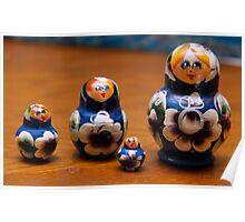 Four blue nesting dolls Poster