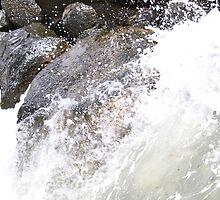 Rock in water's path by chasingangel82