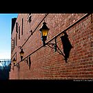 West Main Street Alley With Lanterns - Riverhead, New York  by © Sophie Smith