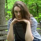 Girl on a Forest Bench by photobylorne
