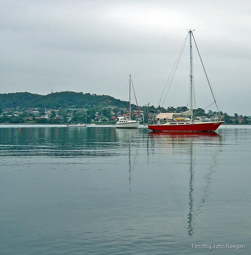 Red boat on blue lake by Timothy John Keegan