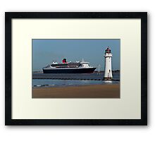 The Queen Mary 2 passing New Brighton Lighthouse on it's way into Liverpool. Framed Print
