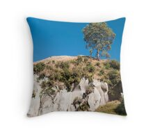 tree on a cliff Throw Pillow