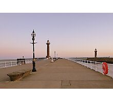 Sunrise over twin lighthouses Whitby. Photographic Print