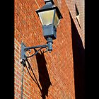 Vintage Street Light Against Red Brick Wall - Riverhead, New York  by © Sophie W. Smith
