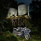 an ACE motorcycle outfit and corrugated water tanks by Frank Kletschkus