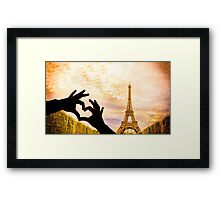 The Eiffel Tower in Paris and hands in a heart shape Framed Print