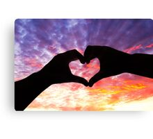 Silhouette hand in heart shape and beautiful sky Canvas Print