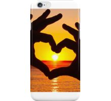 Silhouette hand in heart shape and sunrise over the ocean iPhone Case/Skin