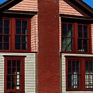 Brick & Red Windows by Curtiss Simpson