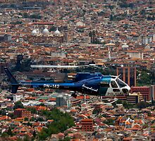 Helicopter Over Cuenca by Paul Wolf