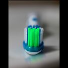 Green, Blue And White Manual Toothbrush by © Sophie W. Smith