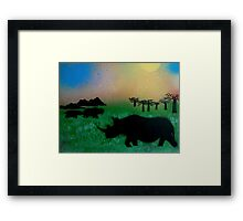 Rhinos in the sunset Framed Print