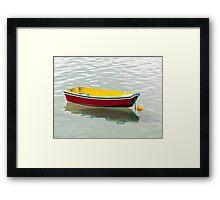 red dinghy Framed Print