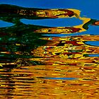 Colorful water reflection by raymona pooler