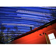 Galaxy Star Trails Pass Over Red Cabin Roof Photographic Print