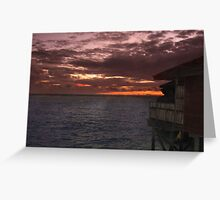 Sunset and water villas  Greeting Card