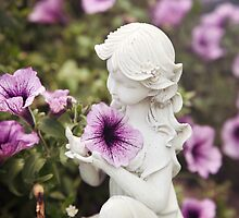 Angel Statue in Garden by Megan Schatzman